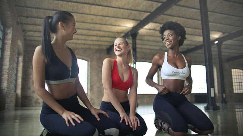 three women in workout clothes