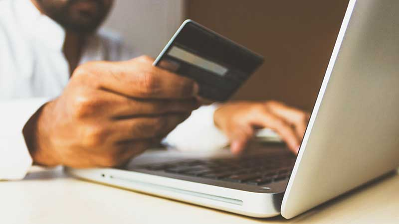 hand holding credit card - shopify affiliate program review