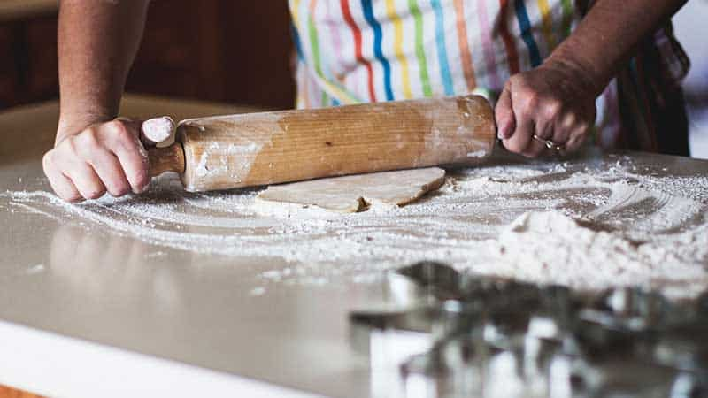baker using a rolling pin