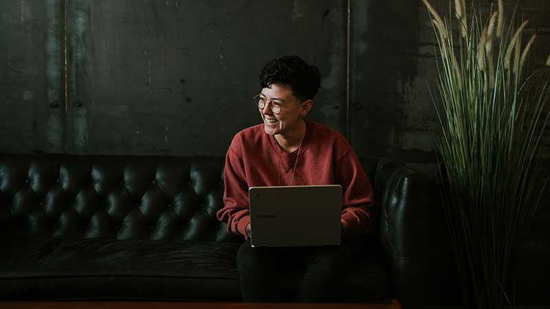 woman smiling using a laptop