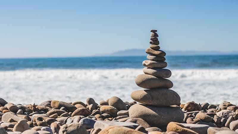 meditation affiliate programs - rocks on a beach