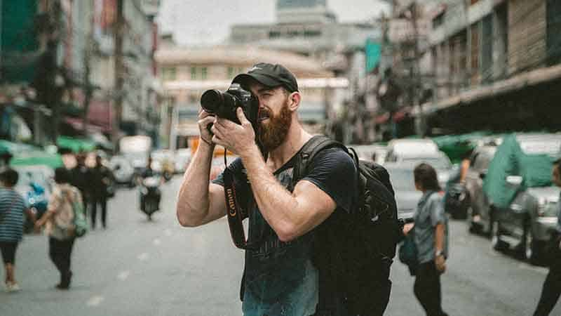 tortuga affiliate - backpacker taking a picture