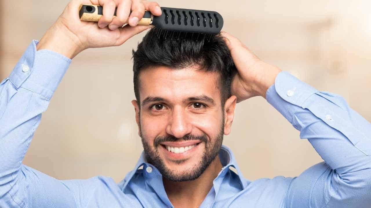 man using a hairbrush